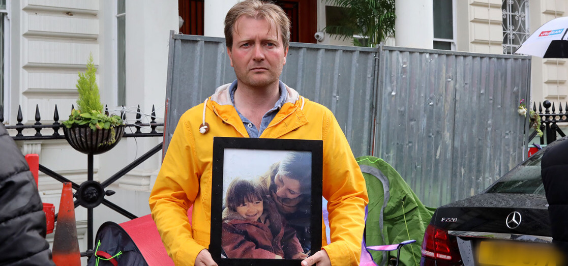 Richard Ratcliffe holds a photograph of Nazanin and their daughter, Gabriella. Richard has been campaigning for Nazanin's release and return to the UK since her arrest in 2016.